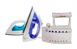 Two modern electric steam iron and charcoal iron Royalty Free Stock Images