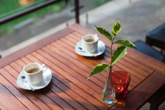 Two modern espresso cups on a wooden table Royalty Free Stock Images
