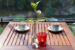 Two modern espresso cups on a wooden table Stock Image
