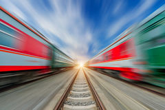 Two modern high speed train with motion blur under the blue sky Royalty Free Stock Photography