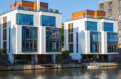 Two modern houses at the water Royalty Free Stock Photo