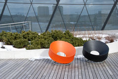 Two modern outdoor seat in street Stock Images