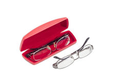 Two modern pairs of eyeglasses and red glasses case Stock Image