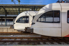 Two modern passenger commuter lightrail trains waiting at a hist Stock Photography