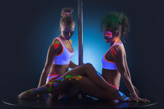 Two modern pole dancers with UV makeup. Image of two modern pole dancers with UV makeup Stock Photography