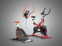 Two modern sport exercise bike yellow purple 3d render on grey b. Ackground Royalty Free Stock Photo