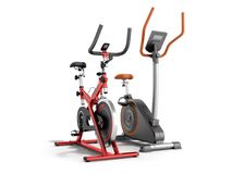 Two modern sport exercise bike yellow purple 3d render on white. Background Royalty Free Stock Image