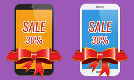Two modern touch-screen mobile phones with ribbon sale banner. Royalty Free Stock Images