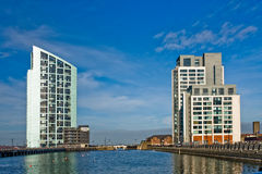Two modern tower block near canal in Liverpol Stock Image
