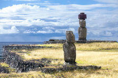 Two Moias in the sea bank. In Easter Island stock photography