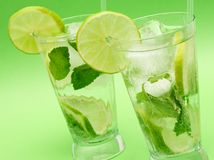 Two mojito cocktails on green background Royalty Free Stock Photo
