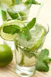 Two mojito cocktails with lime. Mint leaves and ice Royalty Free Stock Photo