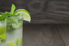 Two mojito cocktails on old oak table Stock Photos