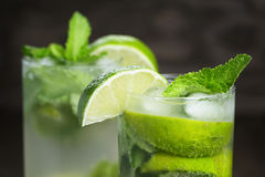 Two mojito cocktails on old oak table Stock Image