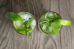Two mojito cocktails on old oak table Royalty Free Stock Photo