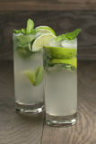 Two mojito cocktails on old oak table Stock Photography