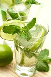 Two mojito cocktails on wooden background royalty free stock photo