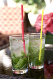Two Mojito Drinks. Photographs of two mojitos drinks in highball glasses stock images