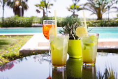 Two mojitoes with glass of Aperol Spritz at background Royalty Free Stock Photos
