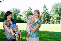 Two Mom's and babe's Royalty Free Stock Photos