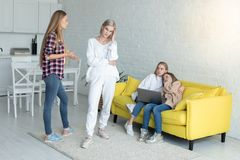 Two mom`s in casual clothes are swearing in the presence of children at home royalty free stock photo