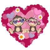 Two Monkeys. On a background of heart Royalty Free Stock Image