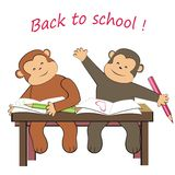 Two monkeys - in class Royalty Free Stock Photo