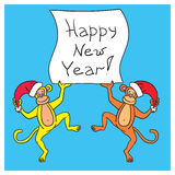 Two monkeys holding a poster with a congratulation happy New Yea. Yellow and red monkey holding a poster with congratulations happy new year 2016 on a blue Royalty Free Stock Photography