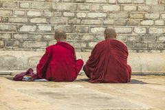 Two monks praying Stock Photos