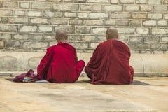 Two monks praying Stock Photos