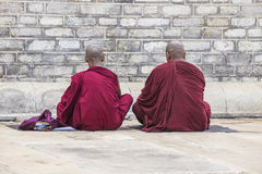 Two monks praying Royalty Free Stock Image