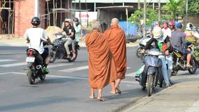 Two monks seeking alms on a street in Hanoi. Hanoi, Vietnam - April 28, 2015. Two monks seeking alms on a street in Hanoi, Vietnam stock footage