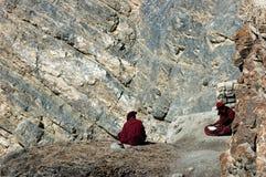 Two monks studying. Pukhtal monastry, Zanskar valley, Ladakh, India Royalty Free Stock Image