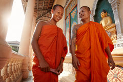 Two monks walk in a buddhist monastery, Asia royalty free stock photography
