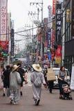 Two monks walk on the street in daegu south korea royalty free stock photo