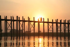 Two monks walk on the wooden bridge Royalty Free Stock Photos