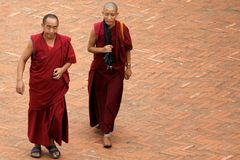 Two monks walking. In the street, in Kathmandu, Nepal. photography taken on 2008 august 28 Royalty Free Stock Images