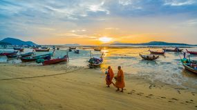 Free Two Monks Walking Alms On The Beach. Stock Images - 106992514