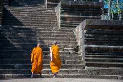 Two monks walking on stone stair Royalty Free Stock Images