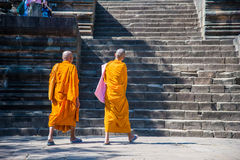 Two monks walking on stone stair Royalty Free Stock Photos