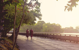Two monks in Yangon. Two monks walking in Yangon, Myanmar Royalty Free Stock Images