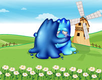 Two monsters comforting each other at the hilltop near the windm Royalty Free Stock Photo