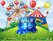 Two monsters at the hilltop with an amusement park. Illustration of the two monsters at the hilltop with an amusement park vector illustration