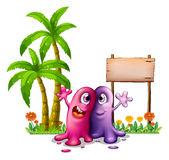 Two monsters near the palm trees Royalty Free Stock Photo