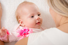 The two-month baby looking at mother royalty free stock photography