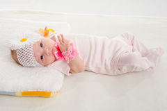 The two-month girl lying on the bed Royalty Free Stock Photo