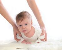 Two month old baby crawling. Royalty Free Stock Image