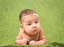 Two-month-old girl with decoration on a head Royalty Free Stock Photo