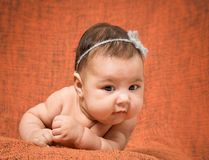 Two-month-old girl with decoration on a head Stock Image