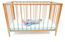 Two months baby boy in a crib Stock Images